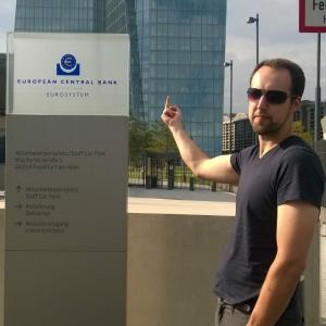 Tobias points his middle finger at a sign of the European Central Bank